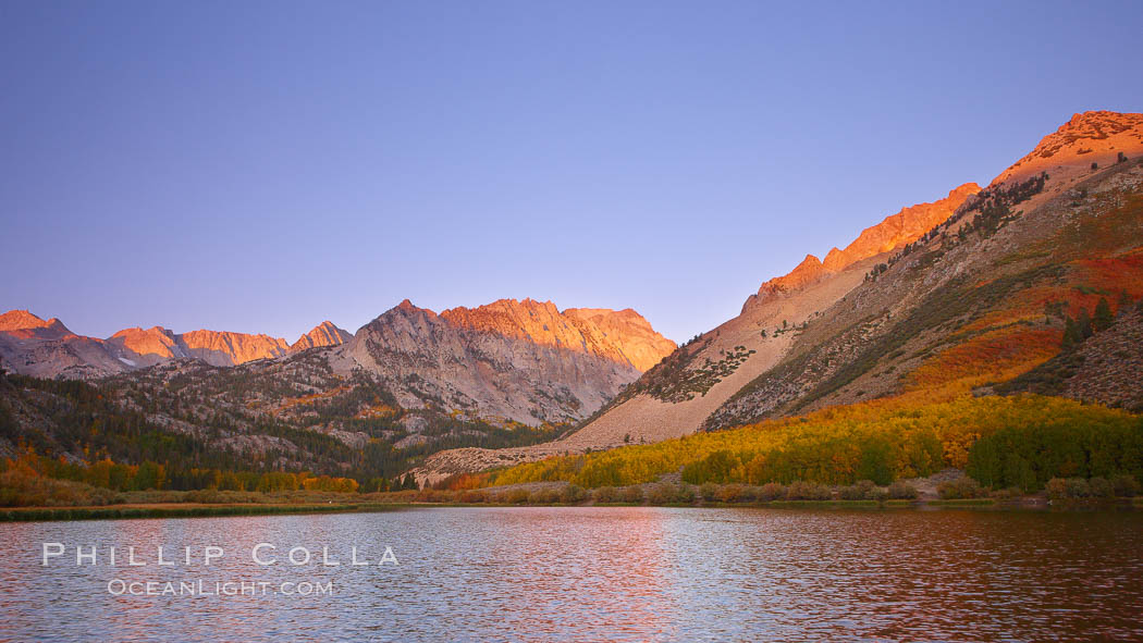 Image 23355, North Lake lit by alpenglow before sunrise, a three frame panorama, with groves of yellow and orange aspen trees on the side of Paiute Peak. Bishop Creek Canyon, Sierra Nevada Mountains, Bishop, California, USA