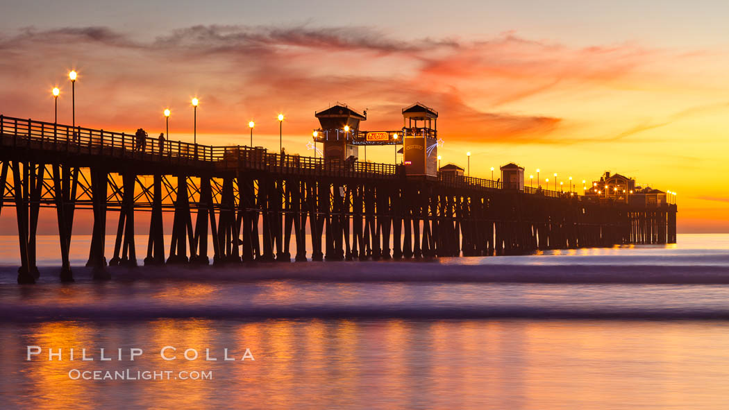 Oceanside Pier at sunset, clouds with a brilliant sky at dusk, the lights on the pier are lit. Oceanside Pier, Oceanside, California, USA, natural history stock photograph, photo id 27614