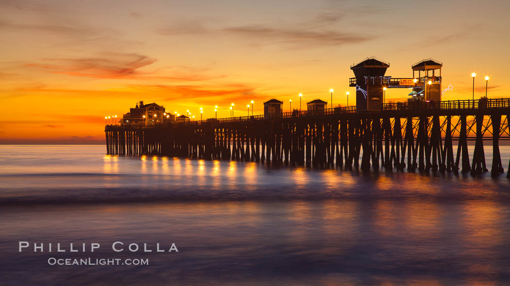 Oceanside Pier at sunset, clouds with a brilliant sky at dusk, the lights on the pier are lit. California, USA, natural history stock photograph, photo id 27616