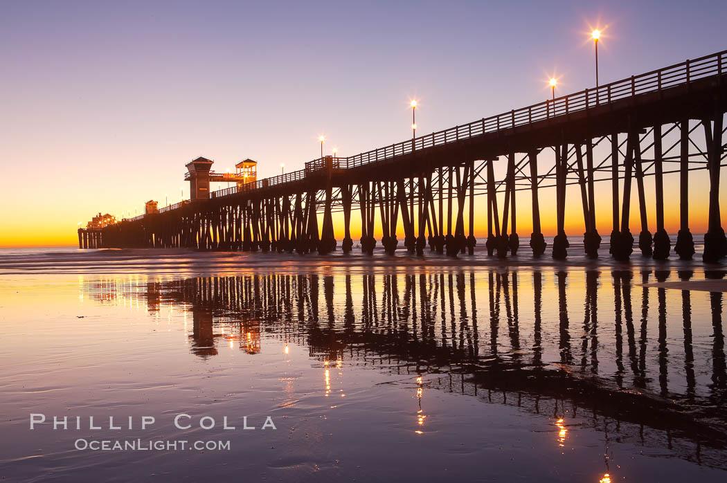 Image 14631, Oceanside Pier at dusk, sunset, night.  Oceanside. Oceanside Pier, Oceanside, California, USA, Phillip Colla, all rights reserved worldwide. Keywords: beach, california, coast, dock, landmark, ocean, oceanside, oceanside pier, outdoors, outside, pier, pilings, san diego, sea, shore, usa, water, wharf.