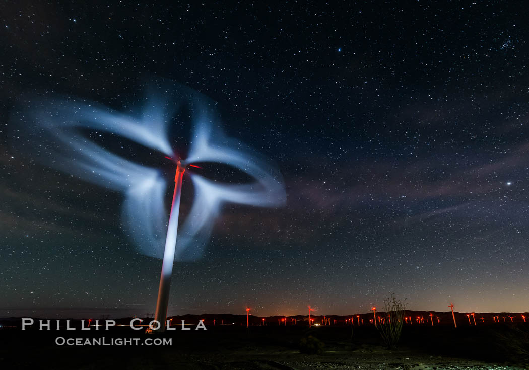Stars rise above the Ocotillo Wind Turbine power generation facility, with a flashlight illuminating the turning turbine blades. California, USA, natural history stock photograph, photo id 30226