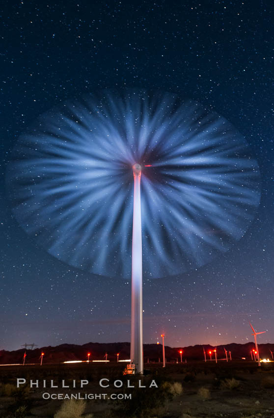 Stars rise above the Ocotillo Wind Turbine power generation facility, with a flashlight illuminating the turning turbine blades, natural history stock photograph, photo id 30221