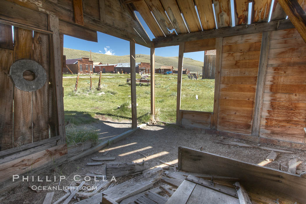 Old barn, interior with Main Street buildings in background. Bodie State Historical Park, California, USA, natural history stock photograph, photo id 23124