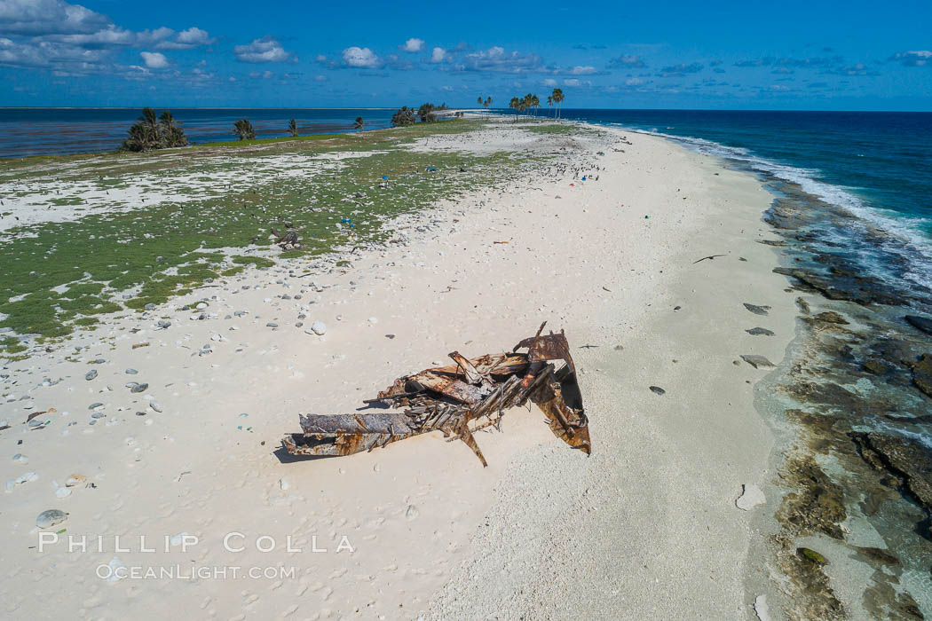 Image 32881, Old shipwreck debris on Clipperton Island aerial photo. Clipperton Island, a minor territory of France also known as Ile de la Passion, is a spectacular coral atoll in the eastern Pacific. By permit HC / 1485 / CAB (France). Clipperton Island, France, Phillip Colla, all rights reserved worldwide. Keywords: aerial, atoll, clipperton island, coral, france, ile de la passion, island, pacific, permit hc   1485   cab, permit hc 1485 cab.