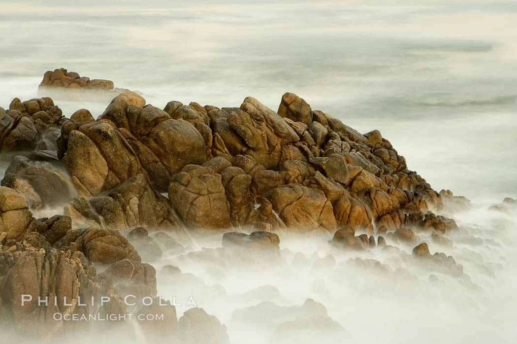 Image 14916, Waves breaking over rocks appear as a foggy mist in this time exposure.  Pacific Grove. Lovers Point, California, USA, Phillip Colla, all rights reserved worldwide. Keywords: california, environment, landscape, lovers point, nature, ocean, outdoors, outside, pacific grove, scene, scenery, scenic, seascape, usa, water.