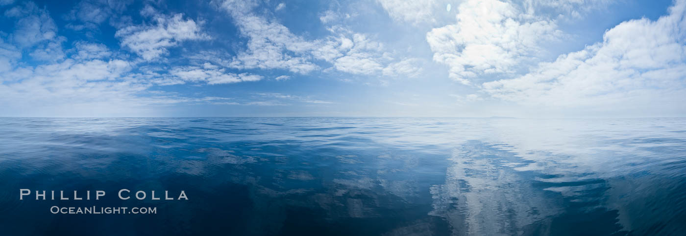 Image 26804, Ocean surface panorama, glassy calm ocean water offshore of California, clouds and sky., Phillip Colla, all rights reserved worldwide. Keywords: clouds, landscape, marine, nature, ocean, ocean surface, outdoors, outside, pacific, panorama, panoramic photo, scene, scenery, scenic, sea, seascape, sky, view.