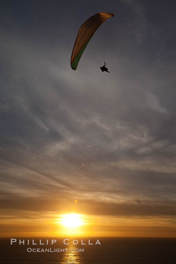 Paraglider soaring at Torrey Pines Gliderport, sunset, flying over the Pacific Ocean. La Jolla, California, USA, natural history stock photograph, photo id 24294