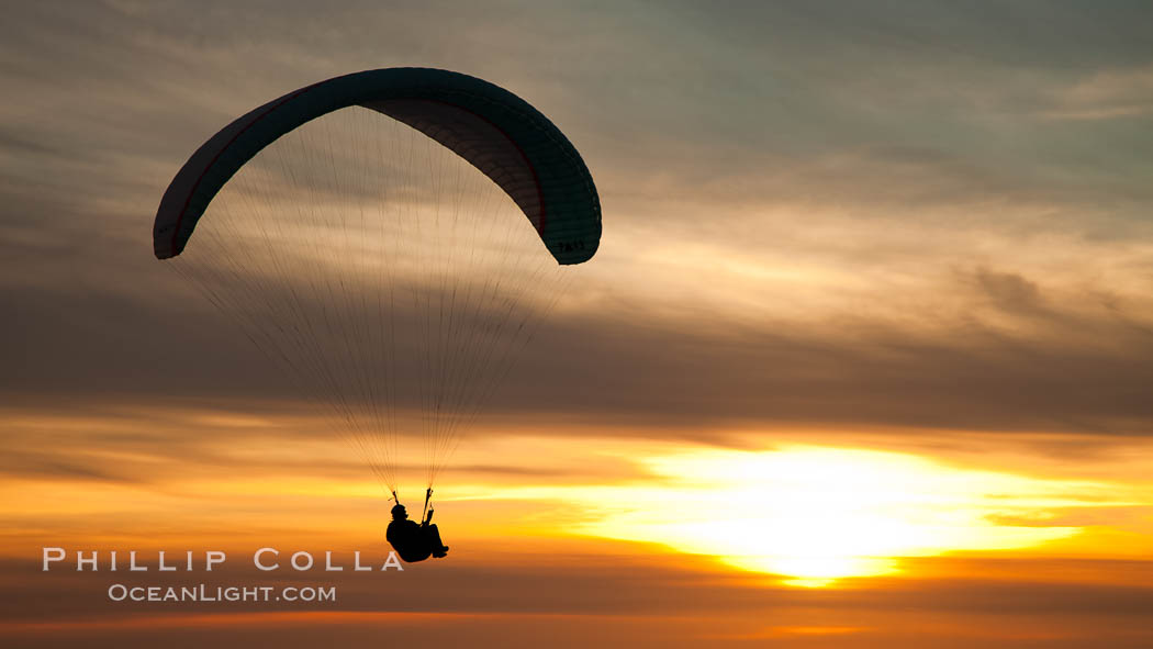 Paraglider soaring at Torrey Pines Gliderport, sunset, flying over the Pacific Ocean. La Jolla, California, USA, natural history stock photograph, photo id 24292