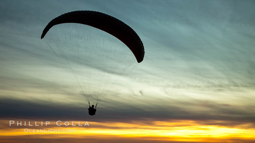 Paraglider soaring at Torrey Pines Gliderport, sunset, flying over the Pacific Ocean. La Jolla, California, USA, natural history stock photograph, photo id 24300