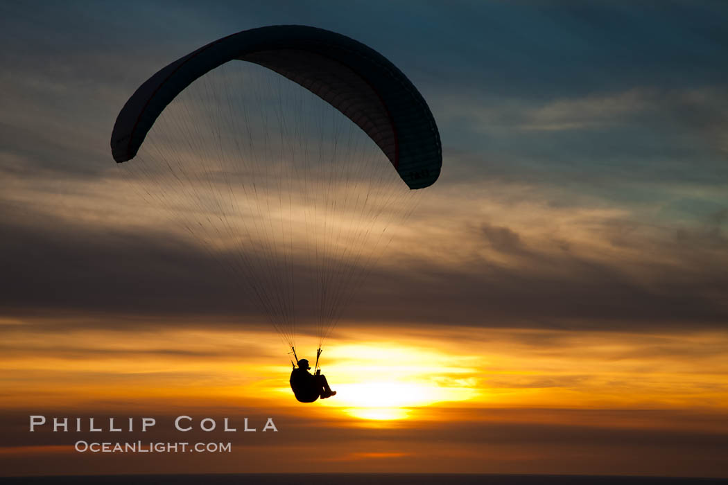Paraglider soaring at Torrey Pines Gliderport, sunset, flying over the Pacific Ocean. La Jolla, California, USA, natural history stock photograph, photo id 24299