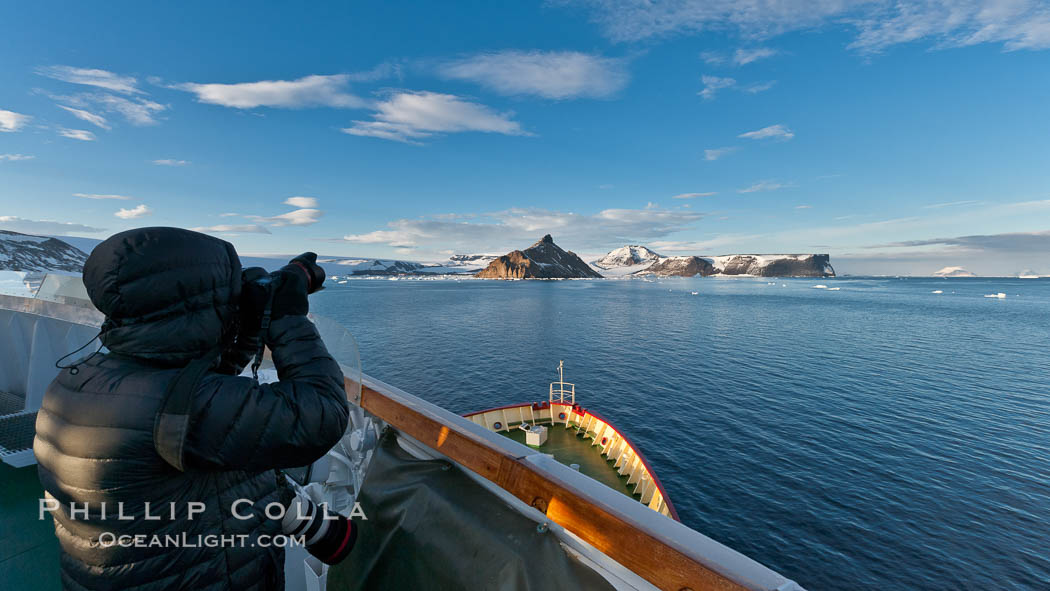 Photographer making pictures as M/V Polar Star approaches Devil Island. Antarctic Peninsula, Antarctica, natural history stock photograph, photo id 26372