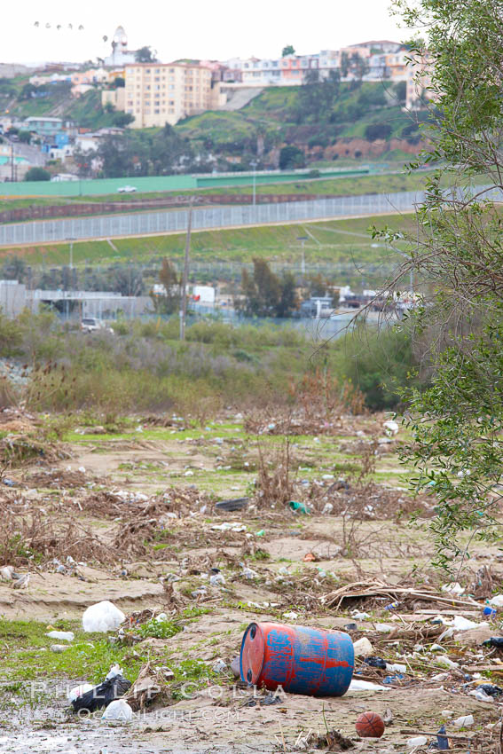 Pollution accumulates in the Tijuana River Valley following winter storms which flush the trash from Tijuana in Mexico across the border into the United States. Imperial Beach, San Diego, California, USA, natural history stock photograph, photo id 22547