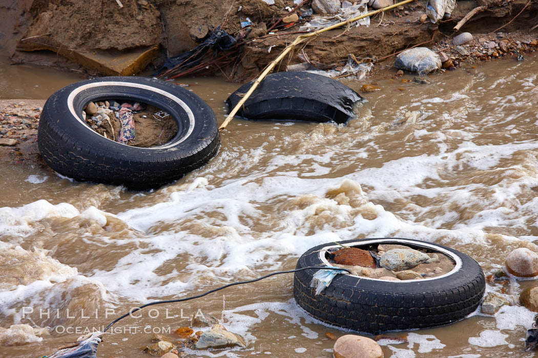 Pollution accumulates in the Tijuana River Valley following winter storms which flush the trash from Tijuana in Mexico across the border into the United States. Imperial Beach, San Diego, California, USA, natural history stock photograph, photo id 22553