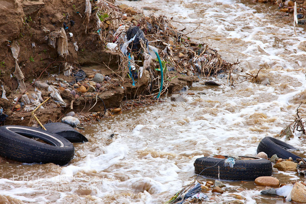 Pollution accumulates in the Tijuana River Valley following winter storms which flush the trash from Tijuana in Mexico across the border into the United States. Imperial Beach, San Diego, California, USA, natural history stock photograph, photo id 22557