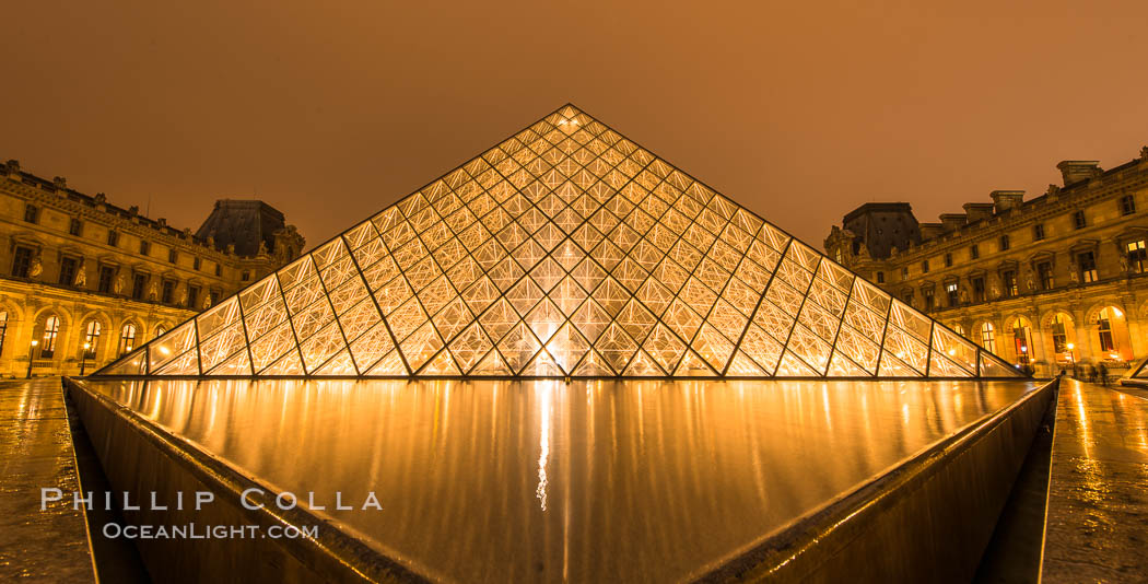 The Louvre Pyramid, Pyramide du Louvre,  large glass and metal pyramid in the main courtyard (Cour Napoleon) of the Louvre Palace (Palais du Louvre) in Paris. Musee du Louvre, France, natural history stock photograph, photo id 28094