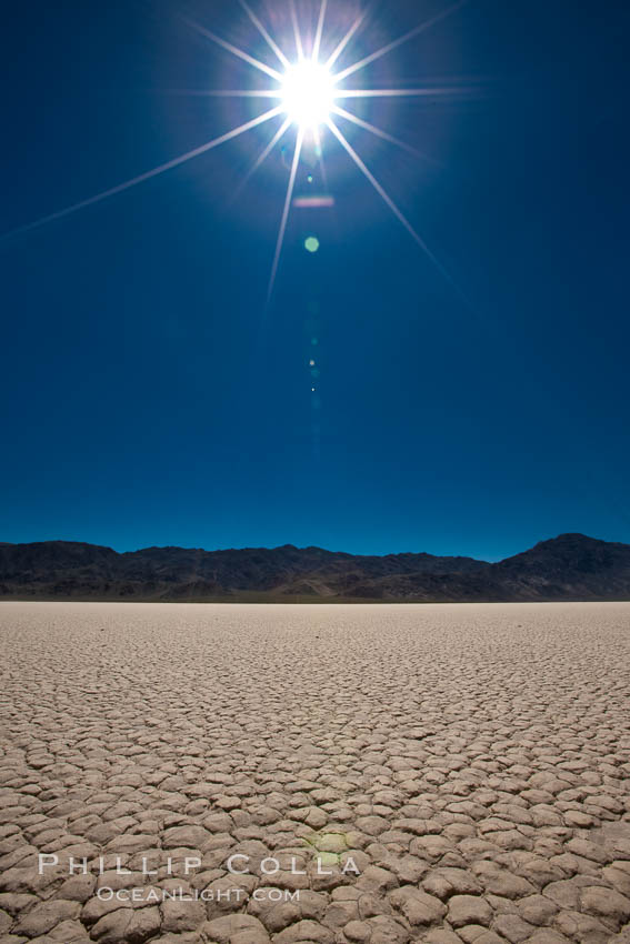 Racetrack Playa, an ancient lake now dried and covered with dessicated mud. Racetrack Playa, Death Valley National Park, California, USA, natural history stock photograph, photo id 25310