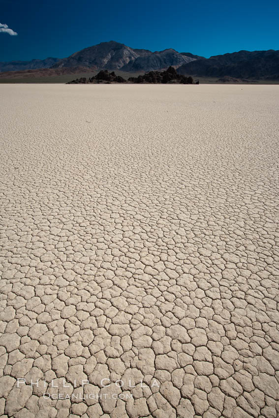 Racetrack Playa, an ancient lake now dried and covered with dessicated mud. Racetrack Playa, Death Valley National Park, California, USA, natural history stock photograph, photo id 25316