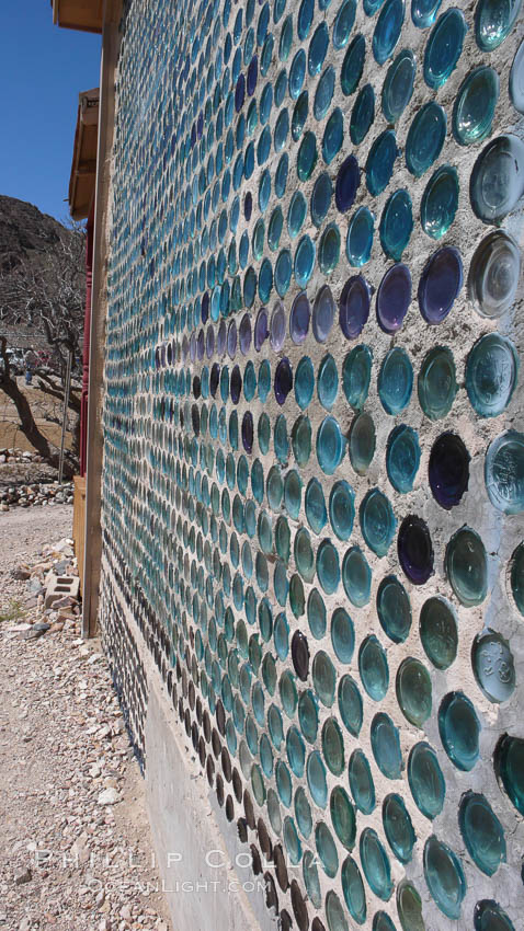 "The strange ""bottle house"" of Rhyolite ghost town, near Death Valley. It was built in 1906 by Tom Kelley of approximately 50,000 beer bottles and was his home for a while. Rhyolite, Nevada, USA, natural history stock photograph, photo id 20590"