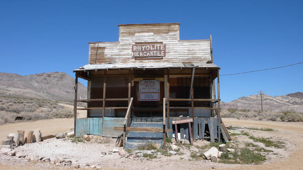 Former mercantile store building, long abandoned, in the ghost town of Rhyolite.  Rhyolite, on the border of Death Valley, was a gold and mineral mining town from 1904 to 1919, when it was abandoned. Rhyolite, Nevada, USA, natural history stock photograph, photo id 20555