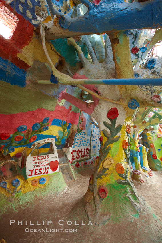 "Salvation Mountain, near the desert community of Slab City and the small town of Niland on the east side of the Salton Sea.  Built over several decades by full-time resident Leonard Knight, who lives at the site, Salvation Mountain was built from over 100,000 gallons of paint, haybales, wood and metal and was created by Mr. Knight to convey the message that ""God Loves Everyone"". California, USA, natural history stock photograph, photo id 22512"