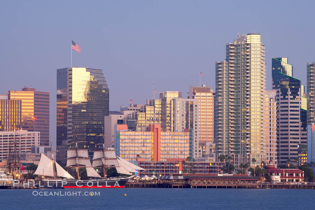 San Diego city skyline at dusk, viewed from Harbor Island, the Star of India at left. San Diego, California, USA, natural history stock photograph, photo id 14538