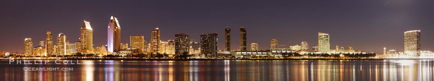 San Diego city skyline at night, showing the buildings of downtown San Diego reflected in the still waters of San Diego Harbor, viewed from Coronado Island.  A panoramic photograph, composite of five separate images. California, USA, natural history stock photograph, photo id 22266