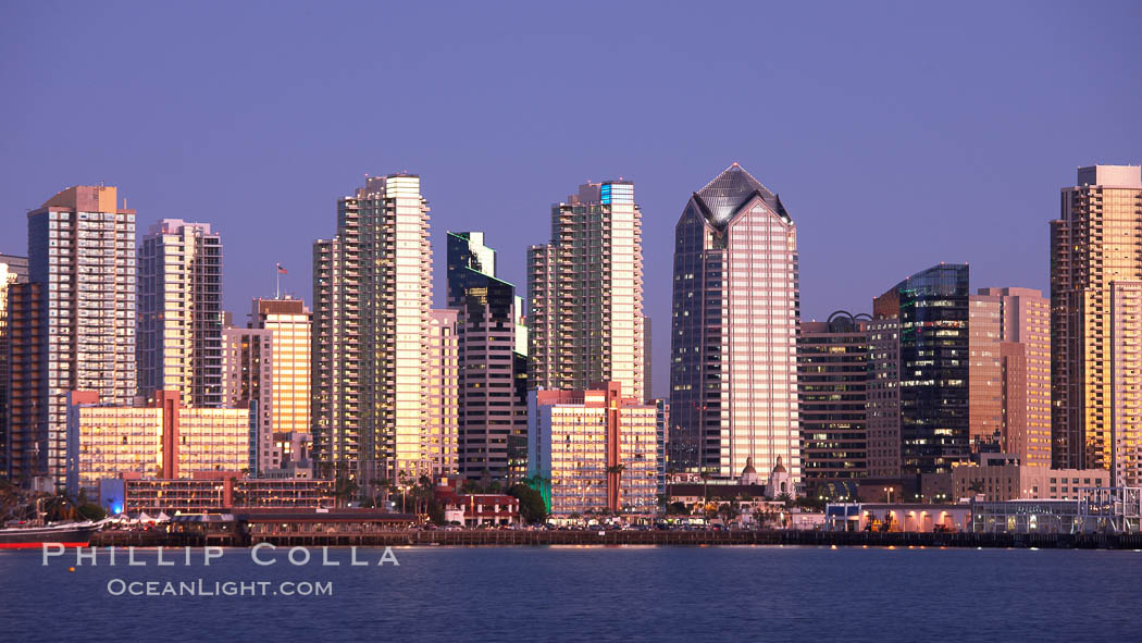 San Diego city skyline at sunset, showing the buildings of downtown San Diego rising above San Diego Harbor, viewed from Harbor Island. San Diego, California, USA, natural history stock photograph, photo id 22258