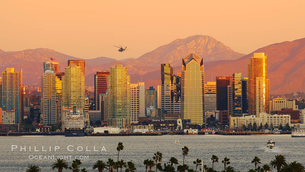 San Diego city skyline, showing the buildings of downtown San Diego rising above San Diego Harbor, viewed from Point Loma at sunset, with mountains of the Cleveland National Forest rising in the distance. San Diego, California, USA, natural history stock photograph, photo id 22260