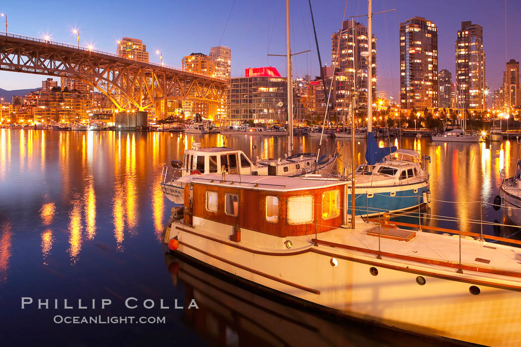 Yaletown section of Vancouver at night, including Granville Island bridge (left), viewed from Granville Island with sailboat in the foreground. British Columbia, Canada, natural history stock photograph, photo id 21169