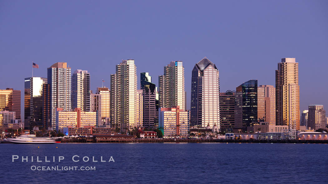 San Diego city skyline at sunset, showing the buildings of downtown San Diego rising above San Diego Harbor, viewed from Harbor Island. San Diego, California, USA, natural history stock photograph, photo id 22261