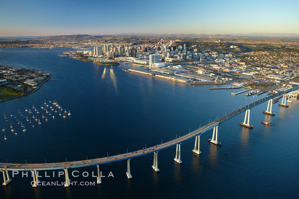 San Diego Coronado Bridge, known locally as the Coronado Bridge, links San Diego with Coronado, California.  The bridge was completed in 1969 and was a toll bridge until 2002.  It is 2.1 miles long and reaches a height of 200 feet above San Diego Bay.  Coronado Island is to the left, and downtown San Diego is to the right in this view looking north. USA, natural history stock photograph, photo id 22365