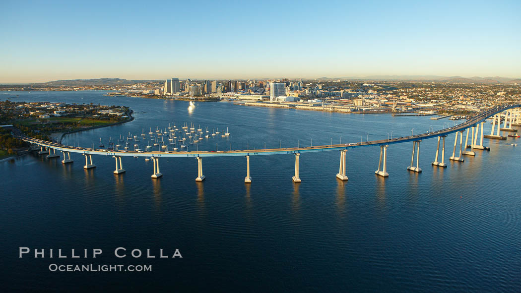 San Diego Coronado Bridge, known locally as the Coronado Bridge, links San Diego with Coronado, California.  The bridge was completed in 1969 and was a toll bridge until 2002.  It is 2.1 miles long and reaches a height of 200 feet above San Diego Bay.  Coronado Island is to the left, and downtown San Diego is to the right in this view looking north. San Diego, California, USA, natural history stock photograph, photo id 22401