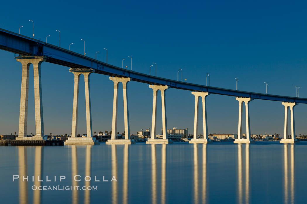 San Diego Coronado Bridge, linking San Diego to the island community of Coronado, spans San Diego Bay.  Dawn. San Diego, California, USA, natural history stock photograph, photo id 27705