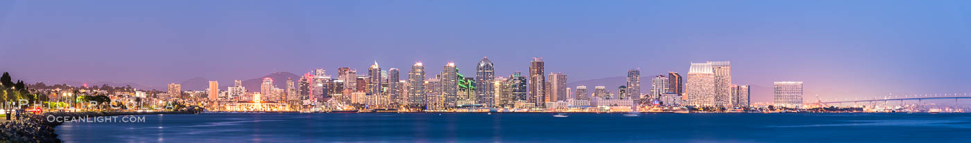 Image 29350, San Diego downtown city skyline at night, viewed from Harbor Island., Phillip Colla, all rights reserved worldwide. Keywords: bay, city skyline, downtown, evening, full moon, harbor, harbor island, moon, night, panorama, panoramic photo, san diego, san diego bay, san diego city skyline, sunset, waterfront.