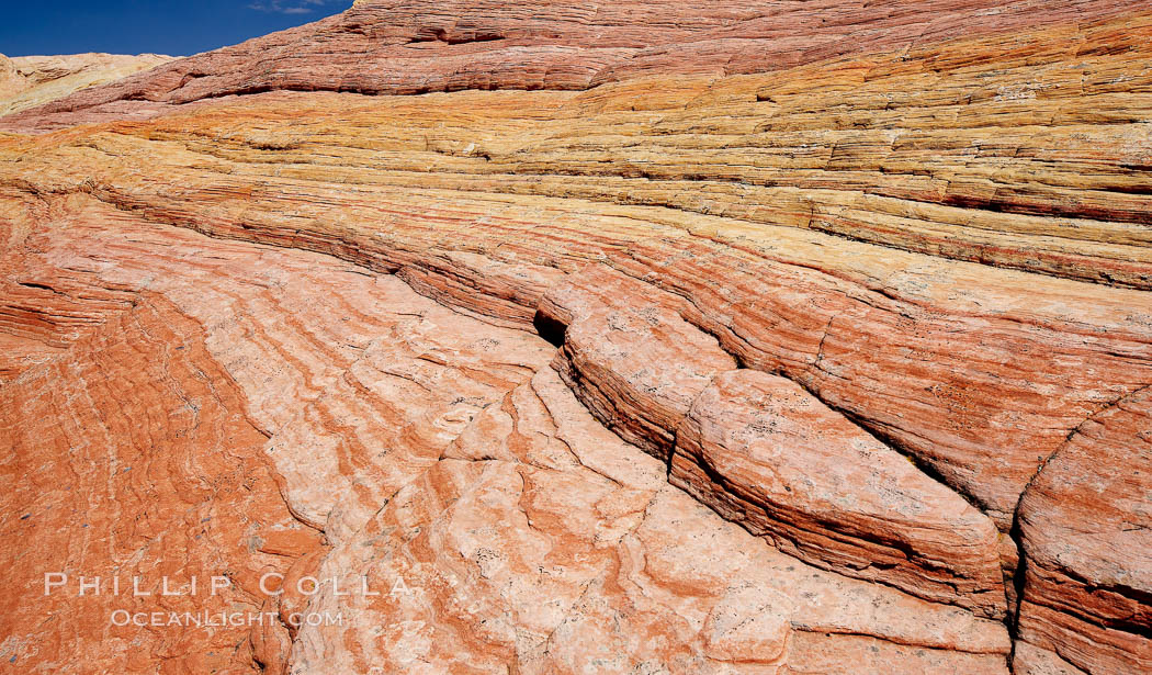 Striations in sandstone tell of eons of sedimentary deposits, a visible geologic record of the time when this region was under the sea. North Coyote Buttes, Paria Canyon-Vermilion Cliffs Wilderness, Arizona, USA, natural history stock photograph, photo id 20665