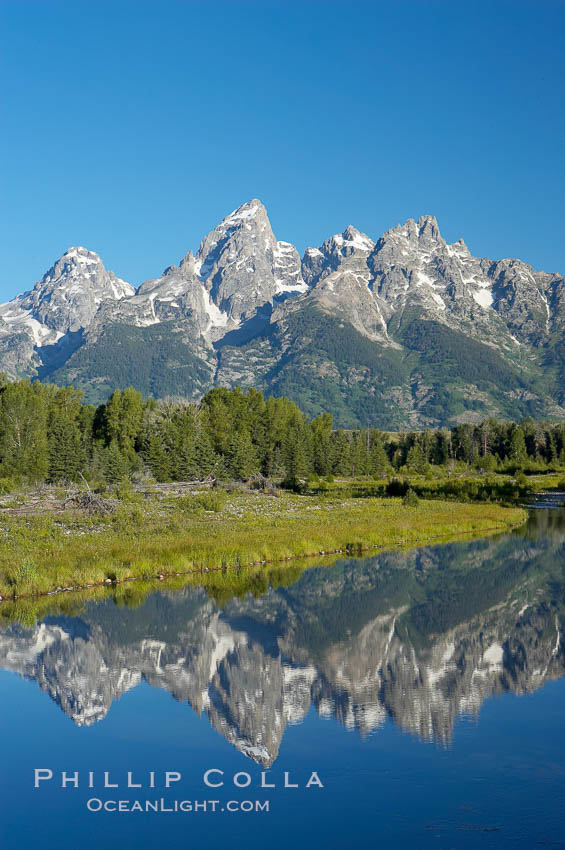 Image 12983, The Teton Range is reflected in the glassy waters of the Snake River at Schwabacher Landing. Schwabacher Landing, Grand Teton National Park, Wyoming, USA, Phillip Colla, all rights reserved worldwide. Keywords: environment, grand teton, grand teton national park, grand tetons, landscape, national parks, nature, outdoors, outside, river, scene, scenery, scenic, schwabacher landing, tetons, usa, water, wyoming.