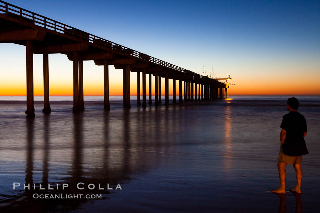 Guy watches the sunset over the SIO pier, the research pier at Scripps Institution of Oceanography SIO. Scripps Institution of Oceanography, La Jolla, California, USA, natural history stock photograph, photo id 26541
