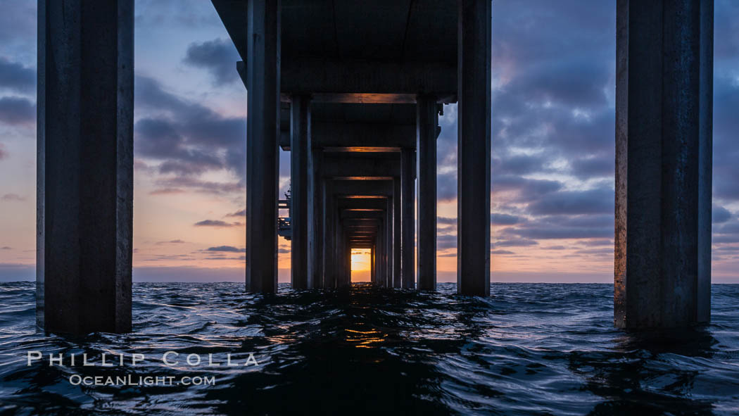 Scripps Pier, Surfer's view from among the waves. Research pier at Scripps Institution of Oceanography SIO, sunset. Scripps Institution of Oceanography, La Jolla, California, USA, natural history stock photograph, photo id 30149