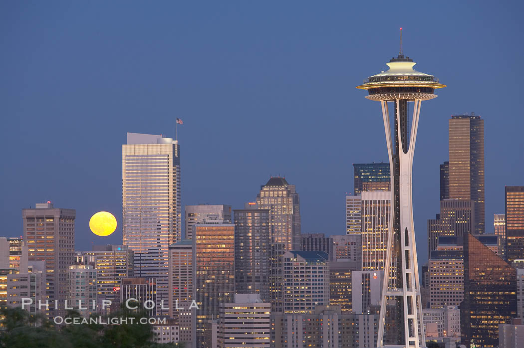 Full moon rises over Seattle city skyline at dusk, Space Needle at right. Washington, USA, natural history stock photograph, photo id 13660