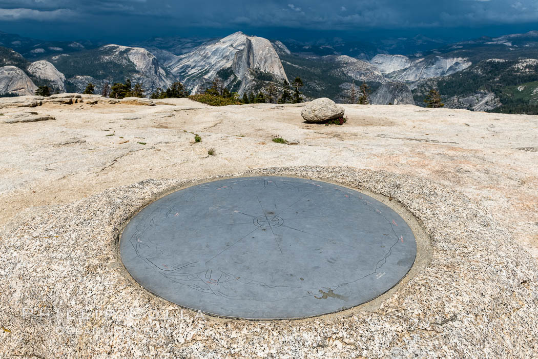 Sentinel Dome summit compass marker, with Half Dome in the distance, Yosemite National Park