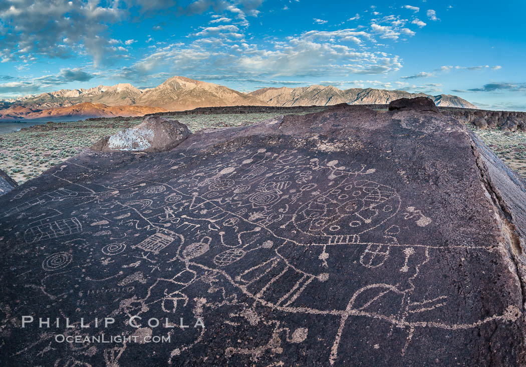 Sky Rock petroglyphs near Bishop, California.  Hidden atop on of the enormous boulders of the Volcanic Tablelands lies Sky Rock, a set of petroglyphs that face the sky.  These superb examples of native American petroglyph artwork are thought to be Paiute in origin, but little is known about them. Bishop, California, USA, natural history stock photograph, photo id 26970