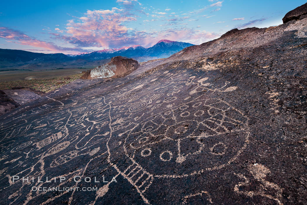 Sky Rock petroglyphs near Bishop, California.  Hidden atop an enormous boulder in the Volcanic Tablelands lies Sky Rock, a set of petroglyphs that face the sky.  These superb examples of native American petroglyph artwork are thought to be Paiute in origin, but little is known about them. Bishop, California, USA, natural history stock photograph, photo id 27006