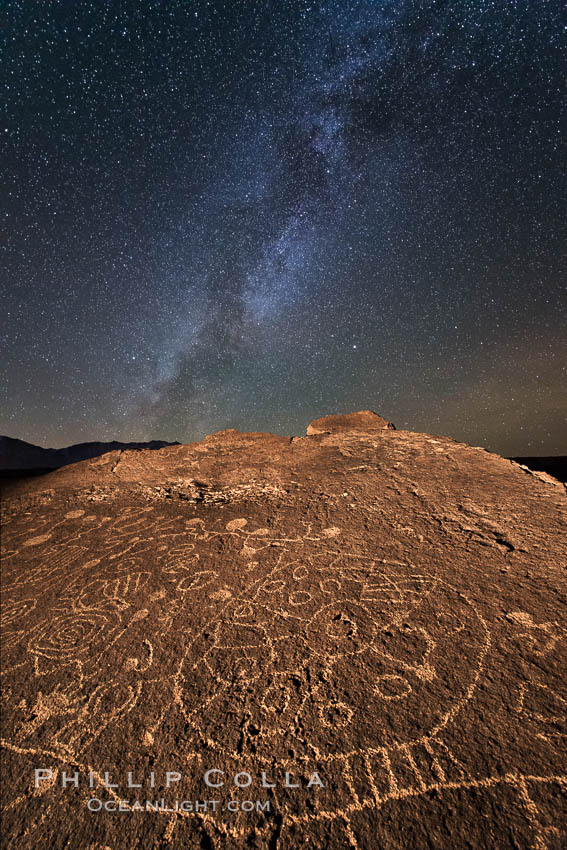 The Milky Way at Night over Sky Rock.  Sky Rock petroglyphs near Bishop, California. Hidden atop an enormous boulder in the Volcanic Tablelands lies Sky Rock, a set of petroglyphs that face the sky. These superb examples of native American petroglyph artwork are thought to be Paiute in origin, but little is known about them. Bishop, California, USA, natural history stock photograph, photo id 28810