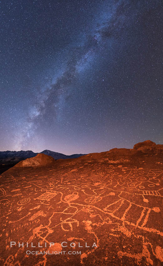 The Milky Way at Night over Sky Rock.  Sky Rock petroglyphs near Bishop, California. Hidden atop an enormous boulder in the Volcanic Tablelands lies Sky Rock, a set of petroglyphs that face the sky. These superb examples of native American petroglyph artwork are thought to be Paiute in origin, but little is known about them. USA, natural history stock photograph, photo id 28808