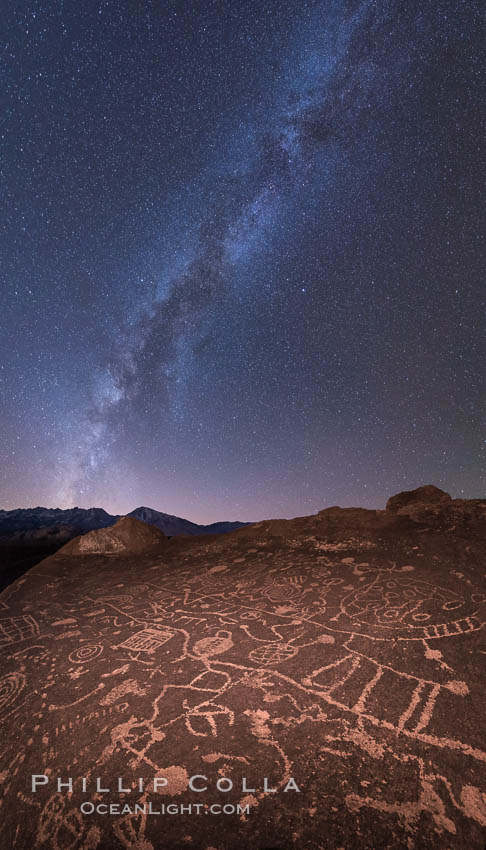 The Milky Way at Night over Sky Rock.  Sky Rock petroglyphs near Bishop, California. Hidden atop an enormous boulder in the Volcanic Tablelands lies Sky Rock, a set of petroglyphs that face the sky. These superb examples of native American petroglyph artwork are thought to be Paiute in origin, but little is known about them. Bishop, California, USA, natural history stock photograph, photo id 28807