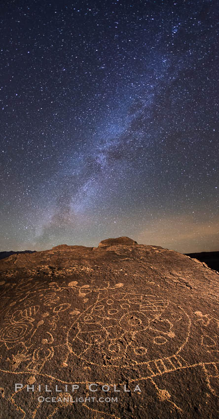 The Milky Way at Night over Sky Rock.  Sky Rock petroglyphs near Bishop, California. Hidden atop an enormous boulder in the Volcanic Tablelands lies Sky Rock, a set of petroglyphs that face the sky. These superb examples of native American petroglyph artwork are thought to be Paiute in origin, but little is known about them. Bishop, California, USA, natural history stock photograph, photo id 28797