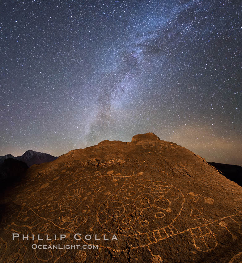 Image 28809, The Milky Way at Night over Sky Rock.  Sky Rock petroglyphs near Bishop, California. Hidden atop an enormous boulder in the Volcanic Tablelands lies Sky Rock, a set of petroglyphs that face the sky. These superb examples of native American petroglyph artwork are thought to be Paiute in origin, but little is known about them. USA, Phillip Colla, all rights reserved worldwide. Keywords: astrophotography, bishop, california, chalfant, chalfant petroglyphs, evening, hidden location, indian, landscape, landscape astrophotography, milky way, milky way galaxy, native american, night, outdoors, outside, owens valley, paiute, paiute-shoshone, petroglyph, pictograph, scene, scenery, scenic, shoshone, shoshone-paiute, sierra, sierra nevada, sky rock, southwest, stars, volcanic tablelands, wall art.