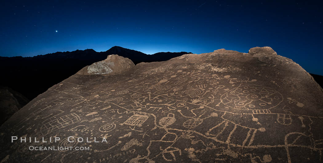 Image 28801, Sunset, planet Venus and stars over Sky Rock.  Sky Rock petroglyphs near Bishop, California. Hidden atop an enormous boulder in the Volcanic Tablelands lies Sky Rock, a set of petroglyphs that face the sky. These superb examples of native American petroglyph artwork are thought to be Paiute in origin, but little is known about them. Bishop, California, USA, Phillip Colla, all rights reserved worldwide. Keywords: astrophotography, bishop, california, chalfant, chalfant petroglyphs, evening, hidden location, indian, landscape, landscape astrophotography, milky way, native american, night, outdoors, outside, owens valley, paiute, paiute-shoshone, petroglyph, pictograph, scene, scenery, scenic, shoshone, shoshone-paiute, sierra, sierra nevada, sky rock, southwest, stars, volcanic tablelands, wall art.