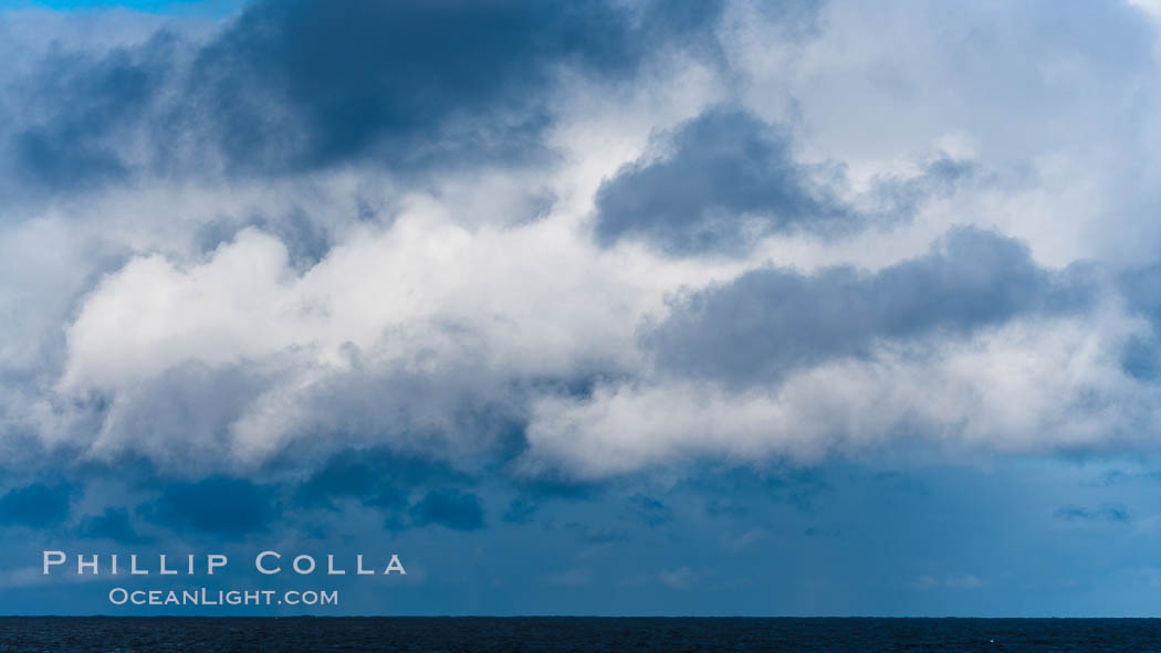 Clouds, weather and light mix in neverending forms over the open ocean of Scotia Sea, in the Southern Ocean., natural history stock photograph, photo id 24760