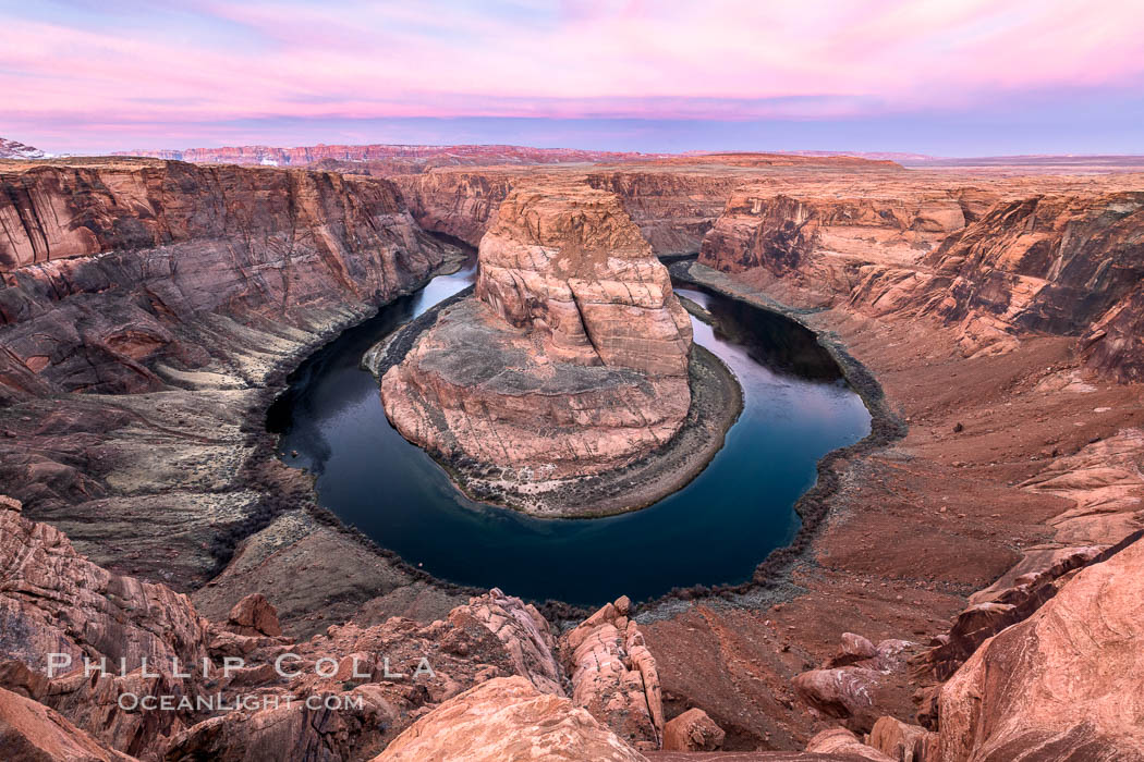 Spectacular Horseshoe Bend sunrise. The Colorado River makes a 180-degree turn at Horseshoe Bend. Here the river has eroded the Navajo sandstone for eons, digging a canyon 1100-feet deep. Page, Arizona, USA, natural history stock photograph, photo id 35939